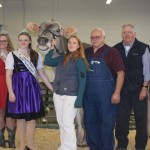 L-R Lee Barber, ringman - Kaylen Miller - Jaynie Rule - Riedland Labron Floral high seller $7100 Lindsey Lepke leads lady - Don Graft representing the buyers Blessing Farm, Rex Mort, Bob Osborn, IN - Darrell Worden, auctioneer -Norman C. Magnussen sale manager.
